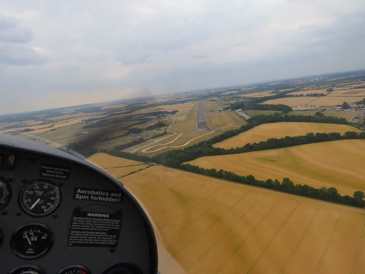 Dimona Motor Glider turning final at Enstone