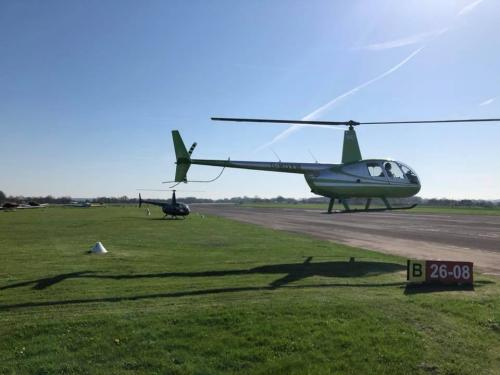 R44 Helicopter Taking Off From Enstone Airfield